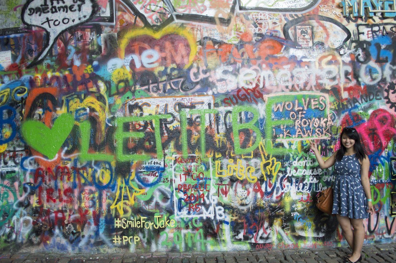Me posing with my graffiti at the John Lennon Wall!