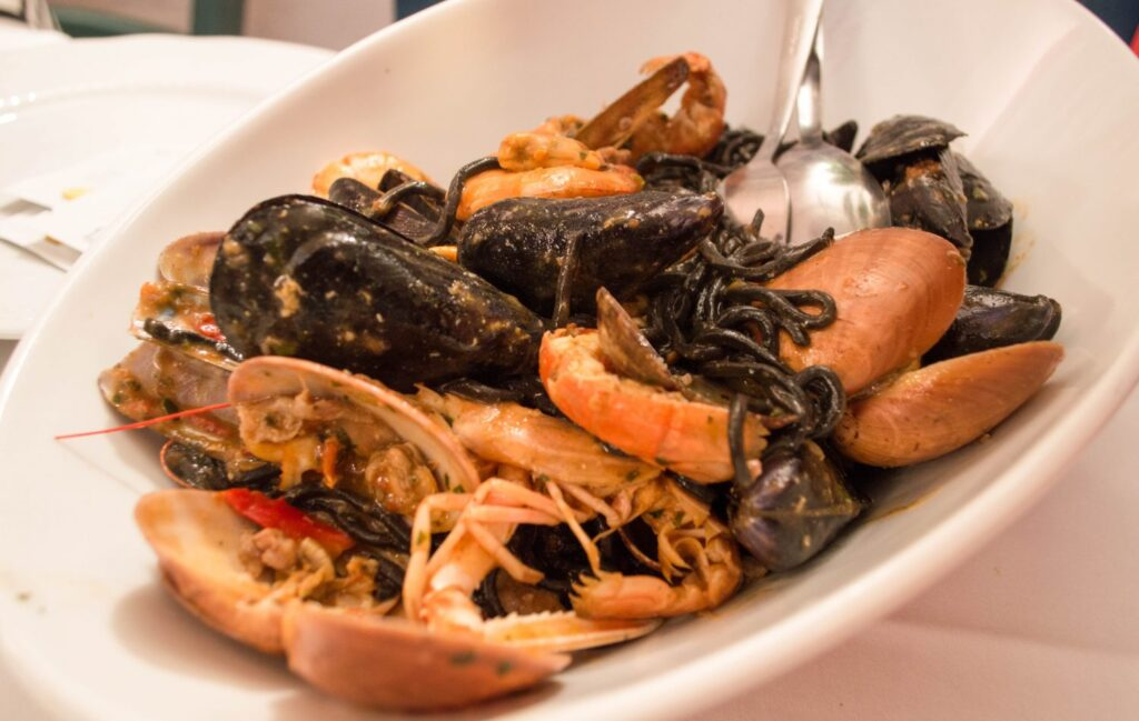Squid ink pasta w/ seafood from Trattoria Dal Billy.