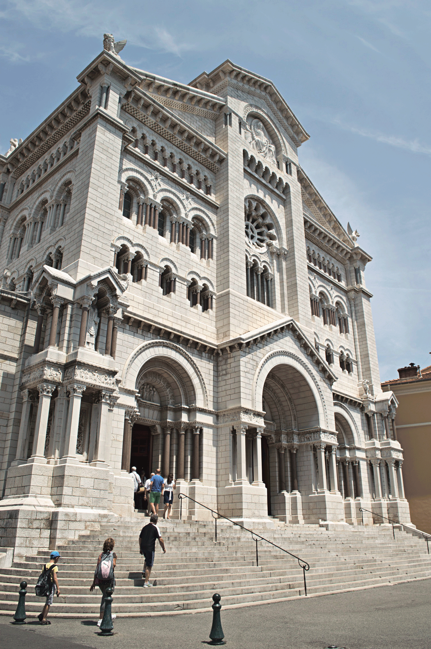 Monaco Cathedral in the day time with tourists walking in