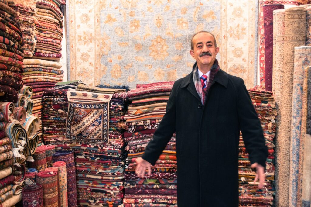 Grand Bazaar Rug Salesman by Christina Guan