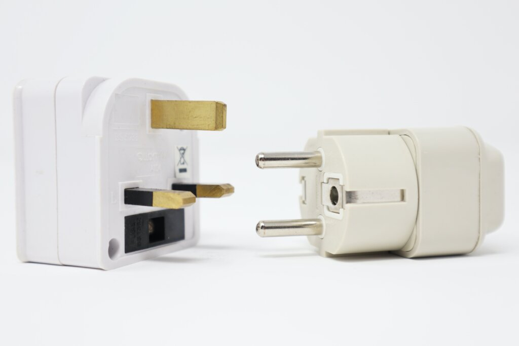 Travel adapters on a white background
