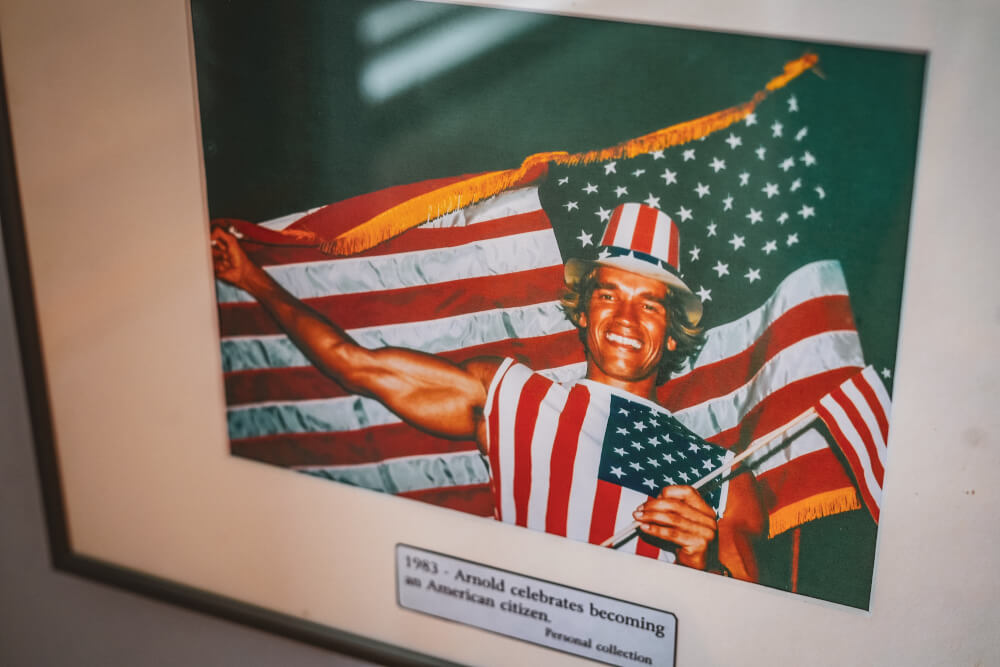 Arnold getting his American citizenship photo at the Arnold Schwarzenegger Museum in Thal, Austria
