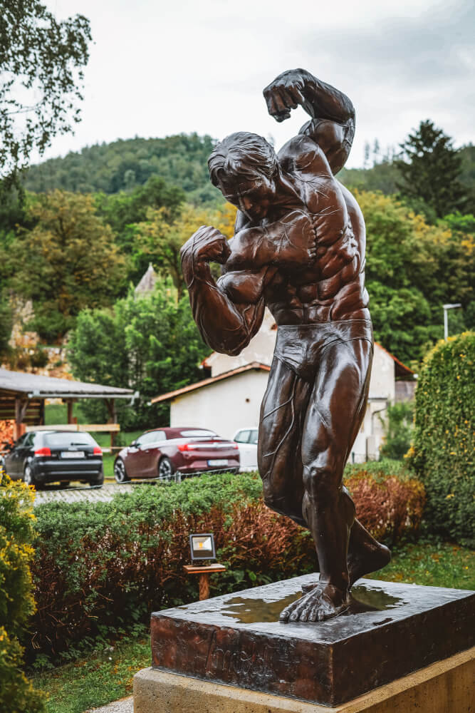 Statue in front of the Arnold Schwarzenegger Museum in Thal, Austria