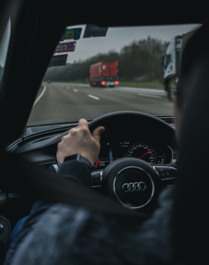 Driver in an Audi car driving on a highway