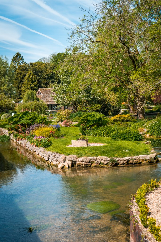 A peaceful garden in Bibury, England along the water.