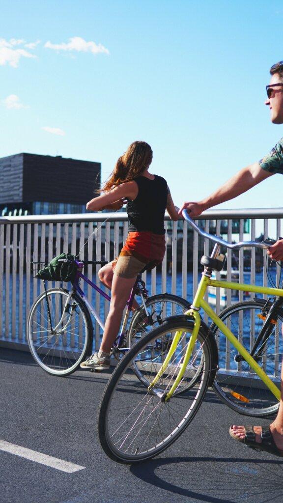 Fit couple riding bikes in Copenhagen