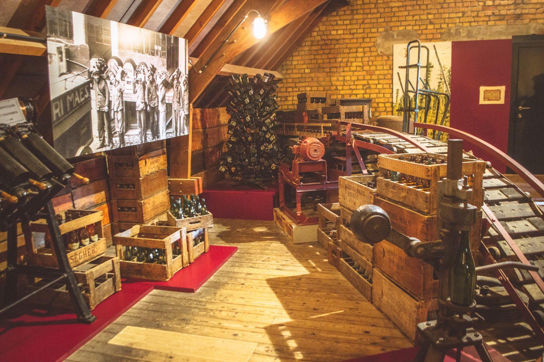 Display room with old bottles in the De Halve Maan Brewery in Bruges, Belgium