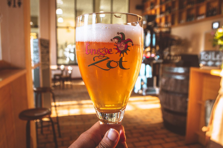 Glass of Brugse Zot beer in Bruges Belgium