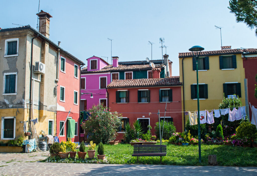 Rainbow houses with hanging laundry in Burano, Italy