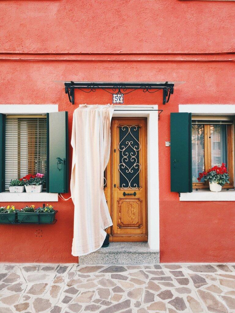 Orange facade of a house in Burano, Italy