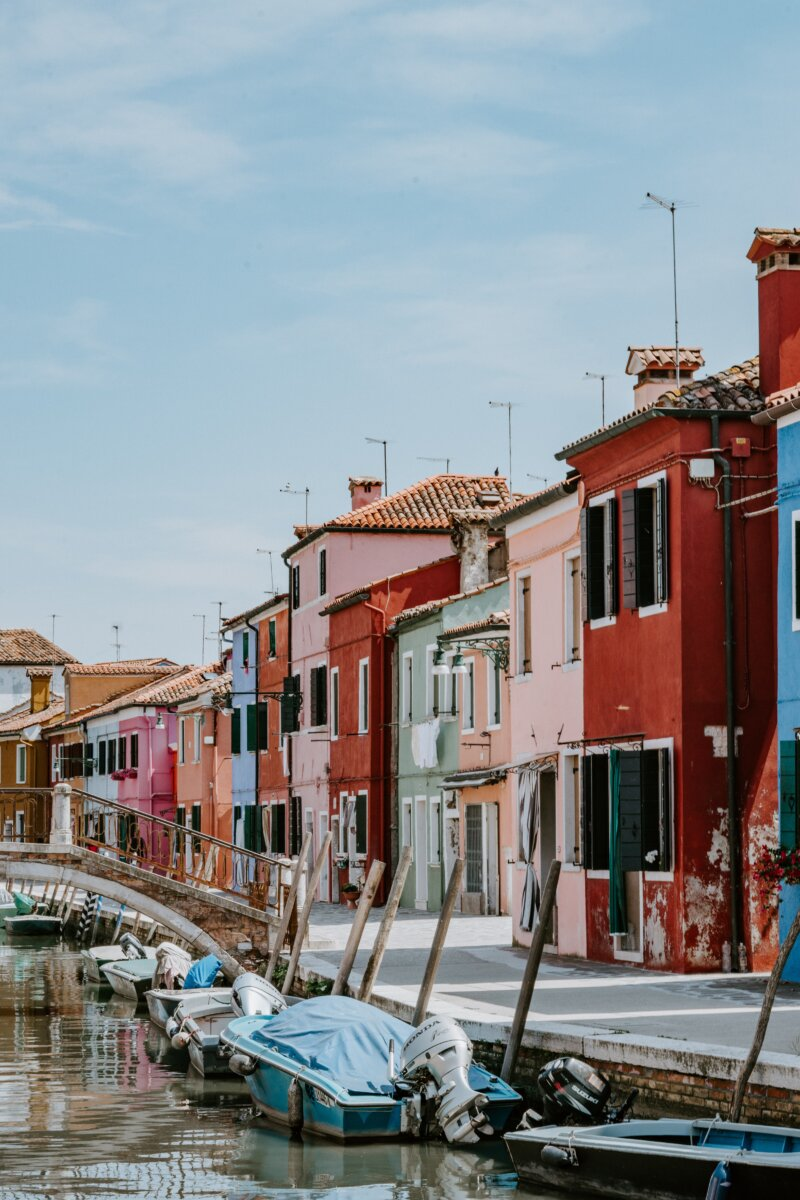 Colourful houses along a canal and bridge in Burano, Italy