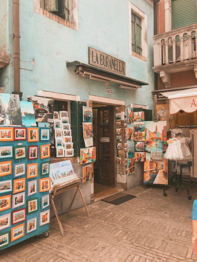 Souvenir shop in Burano selling paintings and magnets