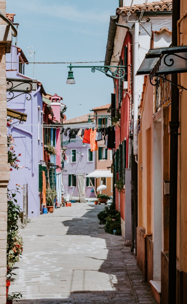 Quiet back street with laundry hanging in Burano, Italy