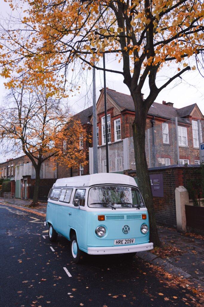 Blue van parked on an empty Autumn street