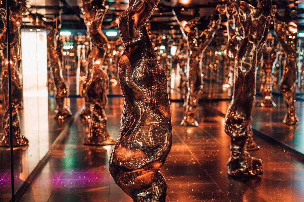Avalon, a space filled with mirrors and bronze trees you encounter en route to Eden on the Celebrity Edge