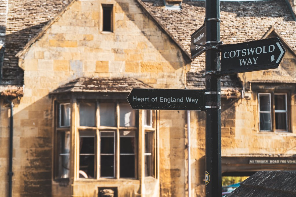 Street signs pointing out the Heart of England Way and Cotswold Way in Chipping Camden, England
