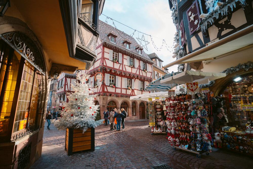 Souvenir shops on a busy street in Colmar France