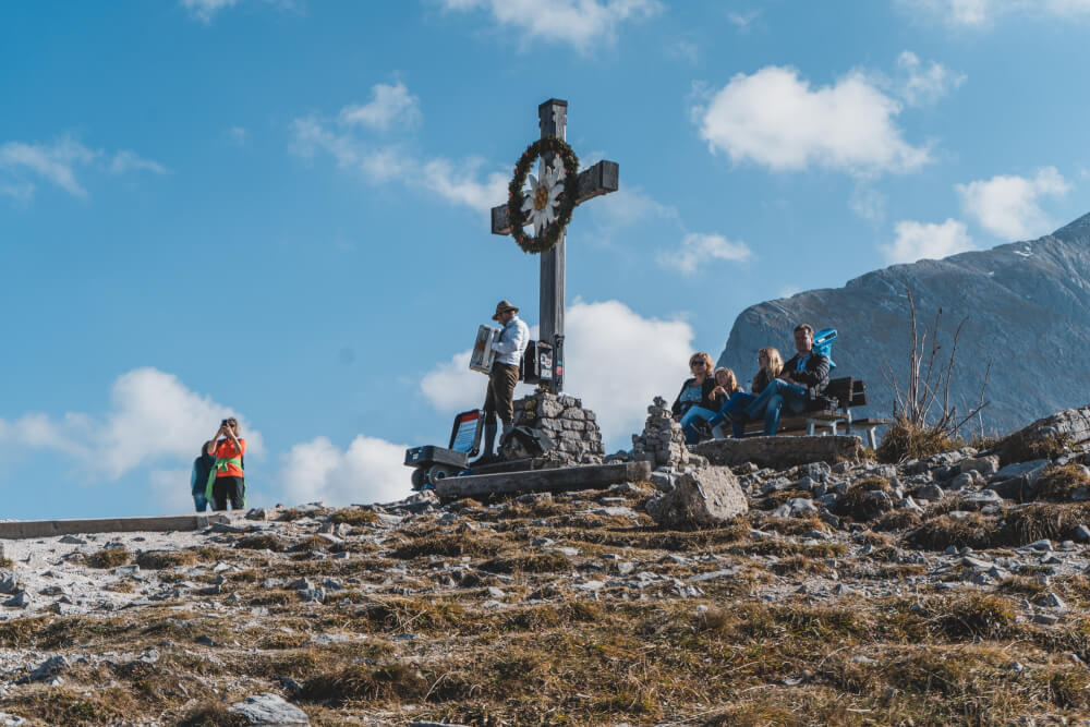 Eagle's Nest cross with an accordion player