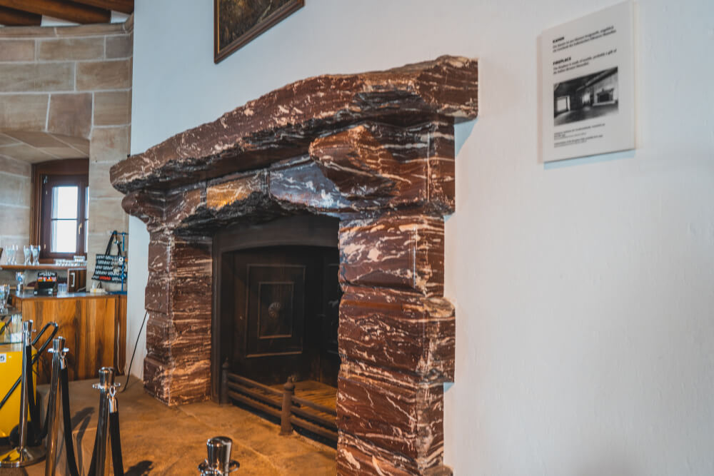 A fireplace at the Eagle's Nest with marble supposedly gifted by Mussolini