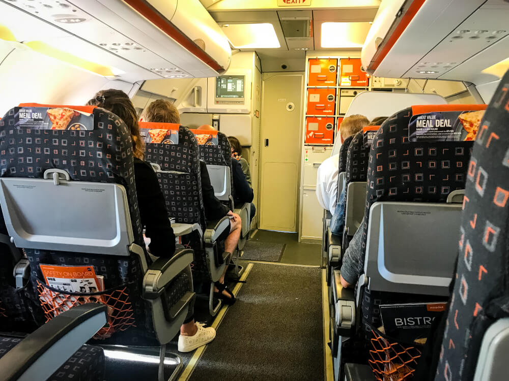 Passengers sitting on an easyJet flight