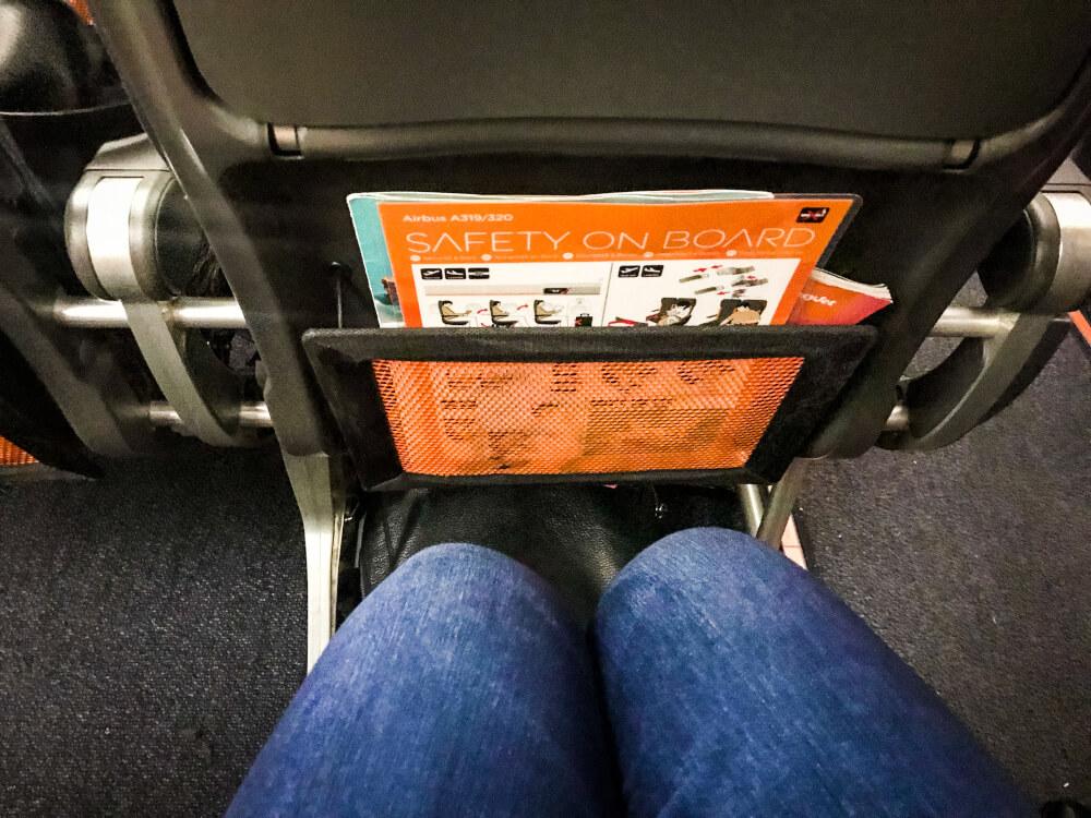 Passenger showing amount of leg room on an easyJet flight