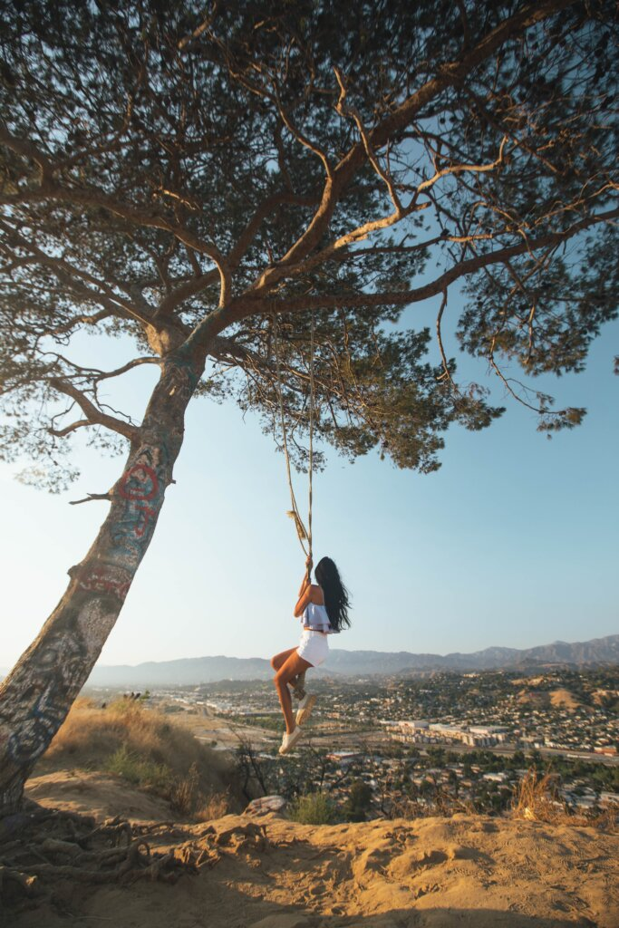 Girl swinging from a tree at Elysian Park in LA