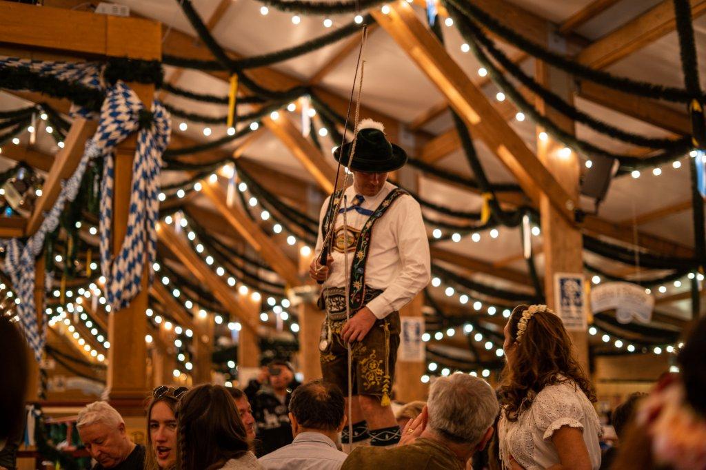 Man wearing traditional Bavarian attire at Oktoberfest in Munich, Germany