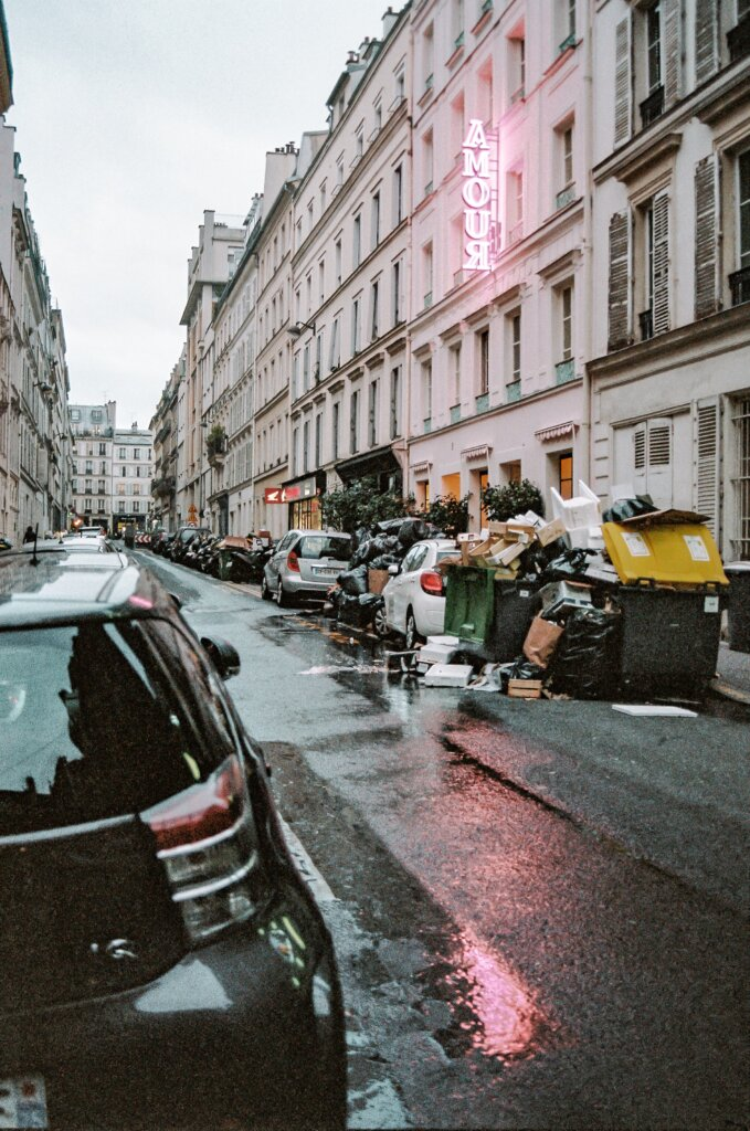 Dumpsters full of garbage on a street in Paris, France