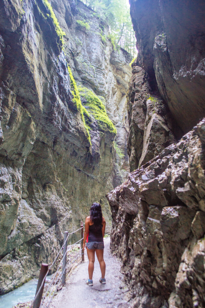 Woman walking at the Partnach Gorge in Garmisch-Partenkirchen, Germany