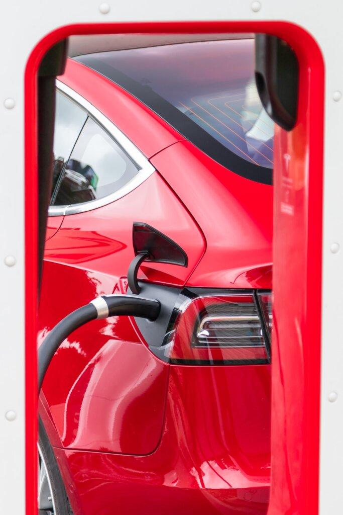 Red car getting gas