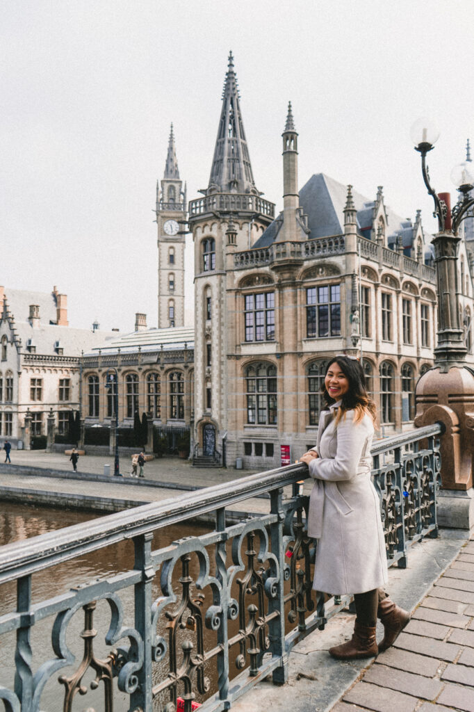 Travel blogger on St Michael's Bridge in Ghent