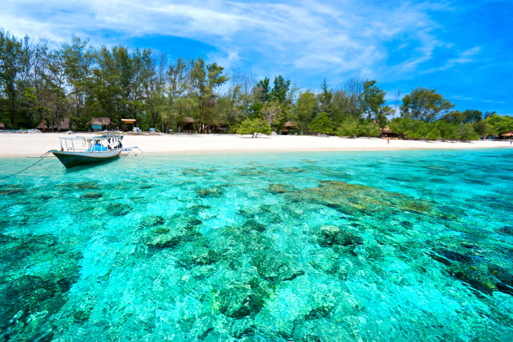 Boat on a beach with turquoise water in Gili Meno, Indonesia