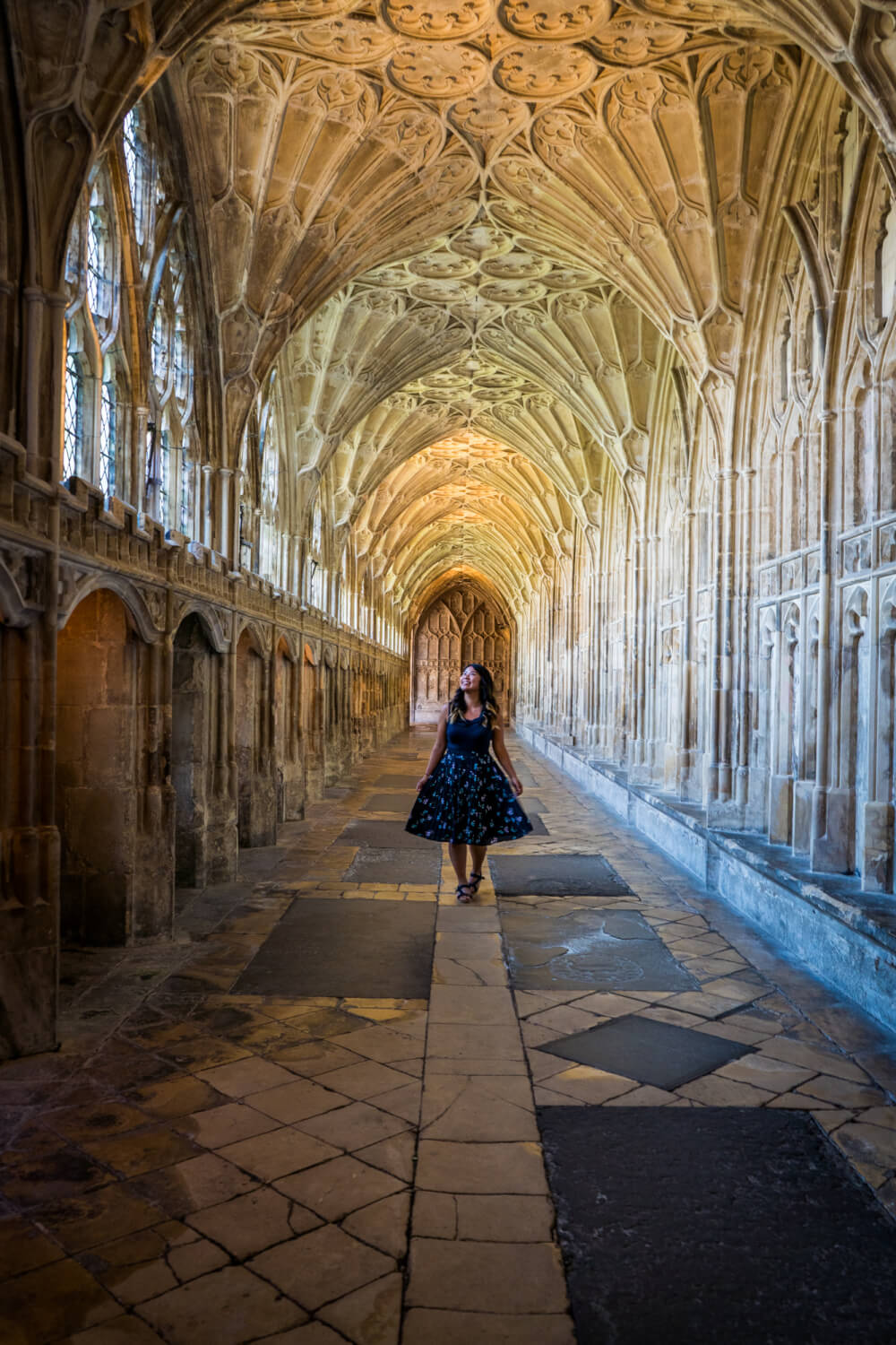 Christina Guan standing in the cloister of Gloucester Cathedral in Gloucester, Gloucestershire, England