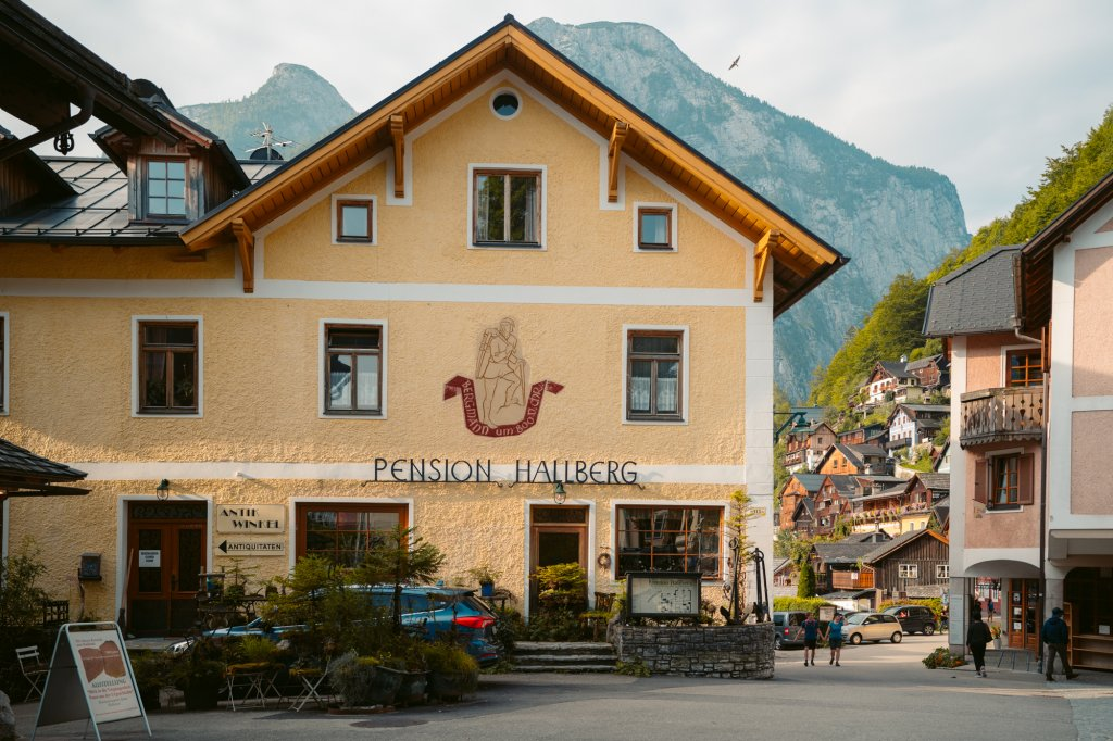 A large yellow pension house in Hallstatt, Austria.