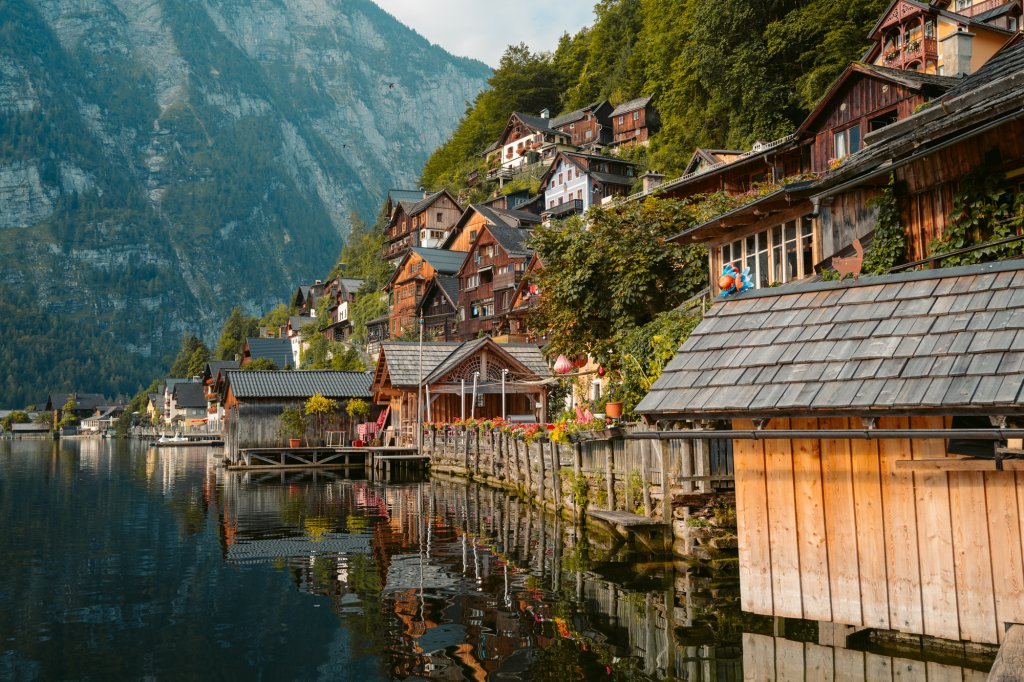 Old wooden houses along the water in Hallstatt, Austria.