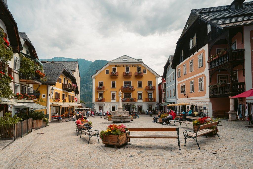 A buzzing Marktplatz filling up with people in Hallstatt, Austria.