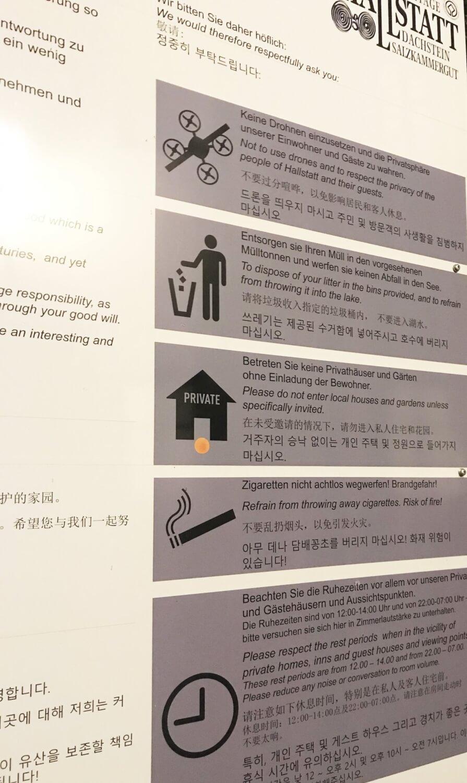 Signs in Hallstatt, Austria describing rules for tourists.