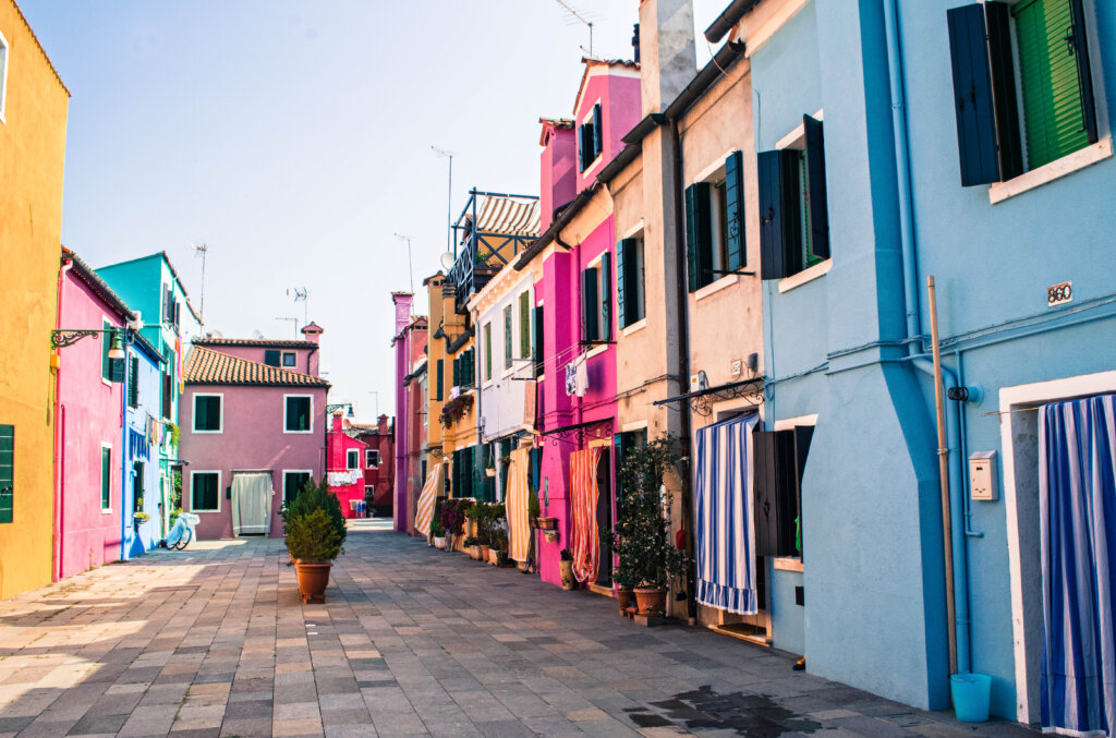 Colourful street lined with rainbow houses in Burano, Italy