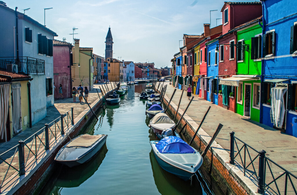 Canal lined with rainbow houses in Burano, Italy
