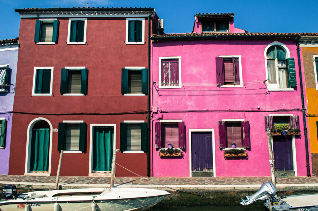 Colourful red and pink houses in Burano, Italy