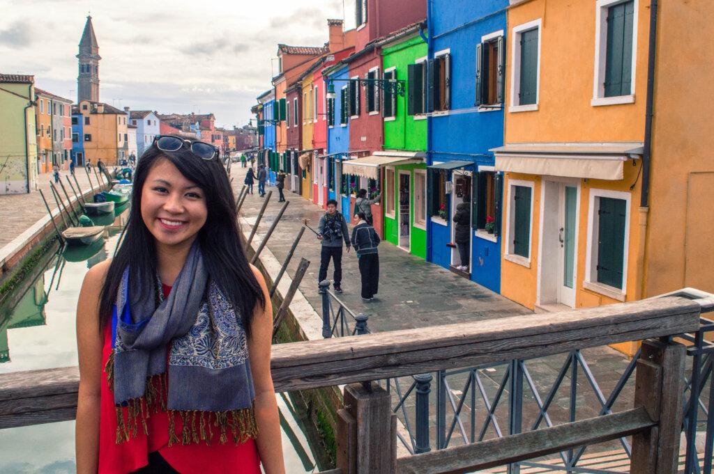 Girl posing on bridge in Burano, Italy