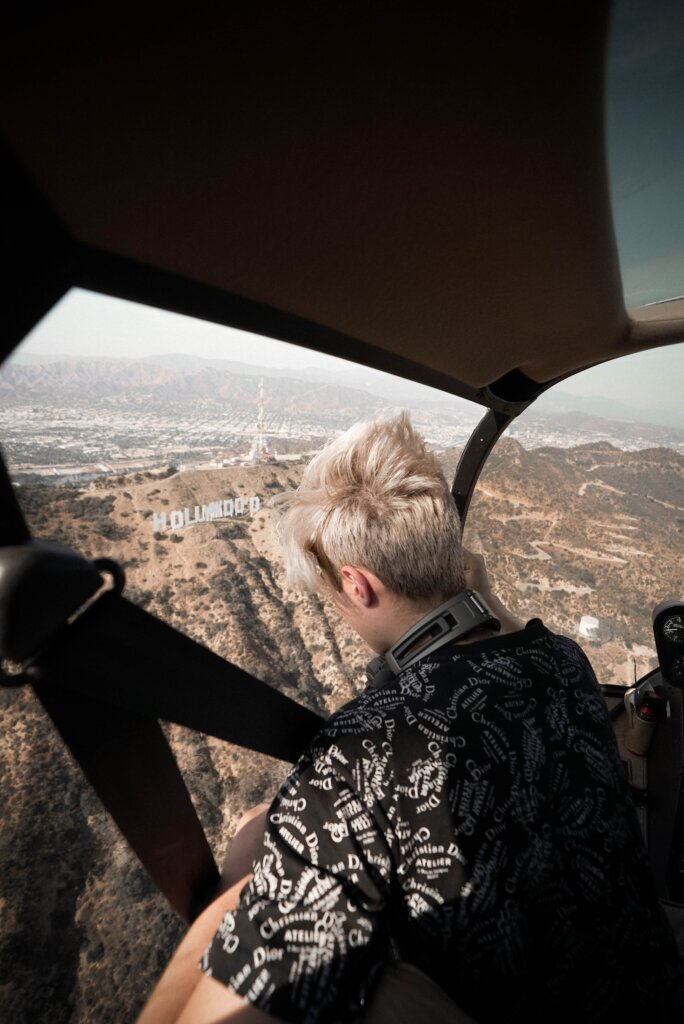 Tourist in a helicopter overlooking the Hollywood sign, one of the best views in LA