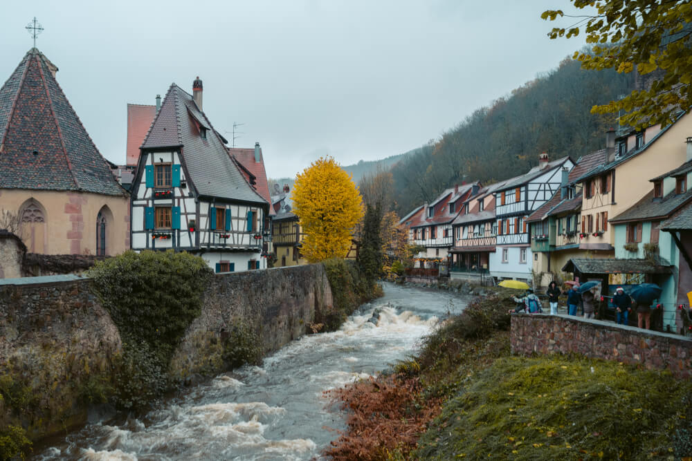 Half timbered houses along the river in Kaysersberg, France