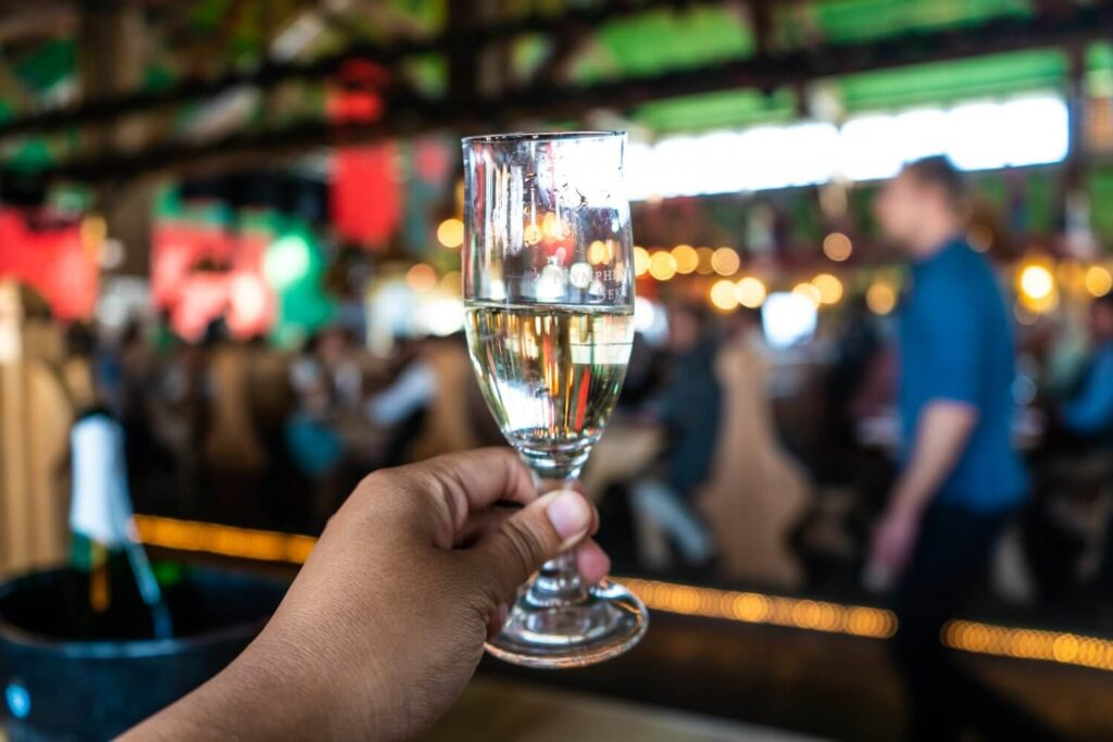 A glass of sparkling wine at the Wine Tent at Munich Oktoberfest in Germany.