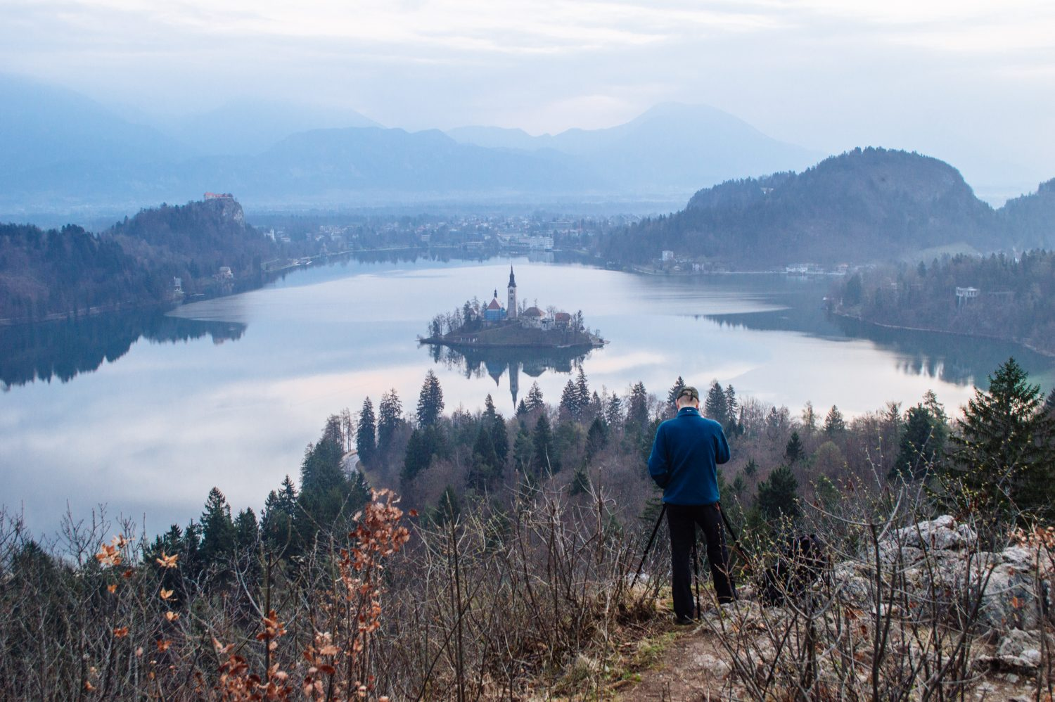 How to get the BEST view of Lake Bled, Slovenia at sunrise. This guide shows you how to hike to this gorgeous viewpoint of Lake Bled and gives you practical advice on how to find the trail head and more!