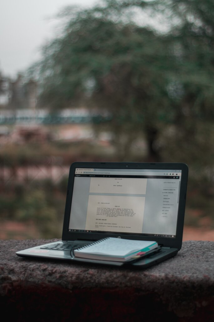 Word document on a laptop perched on a ledge