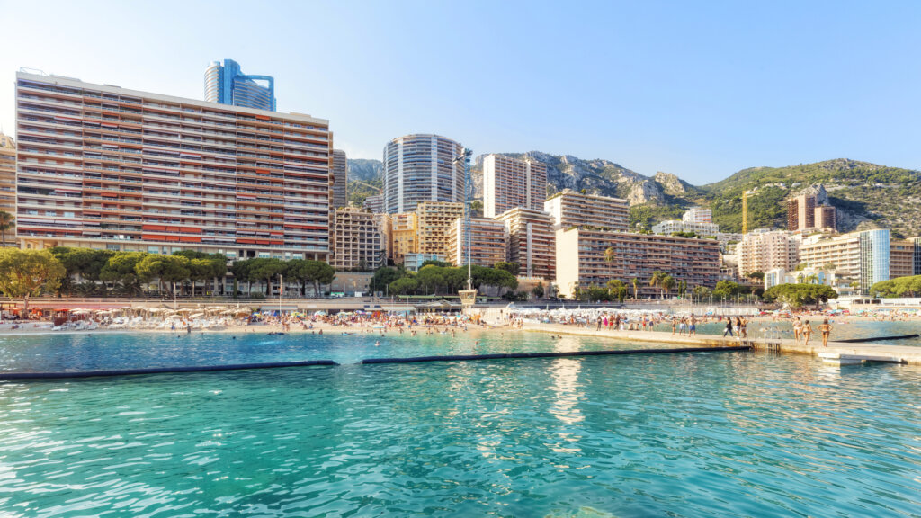 Beach with bright blue water in Monaco