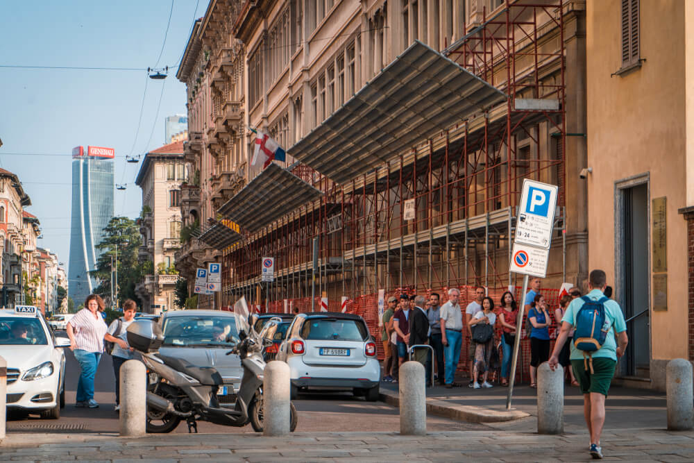 Tourists waiting in a line-up outside the Last Supper in Milan