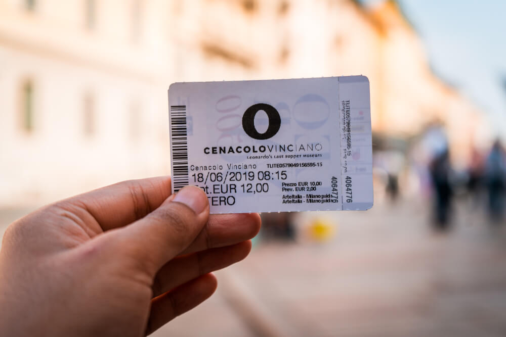 Hand holding a ticket for the Last Supper in Milan, Italy