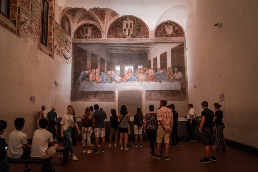 Tourists admiring the Last Supper in Milan